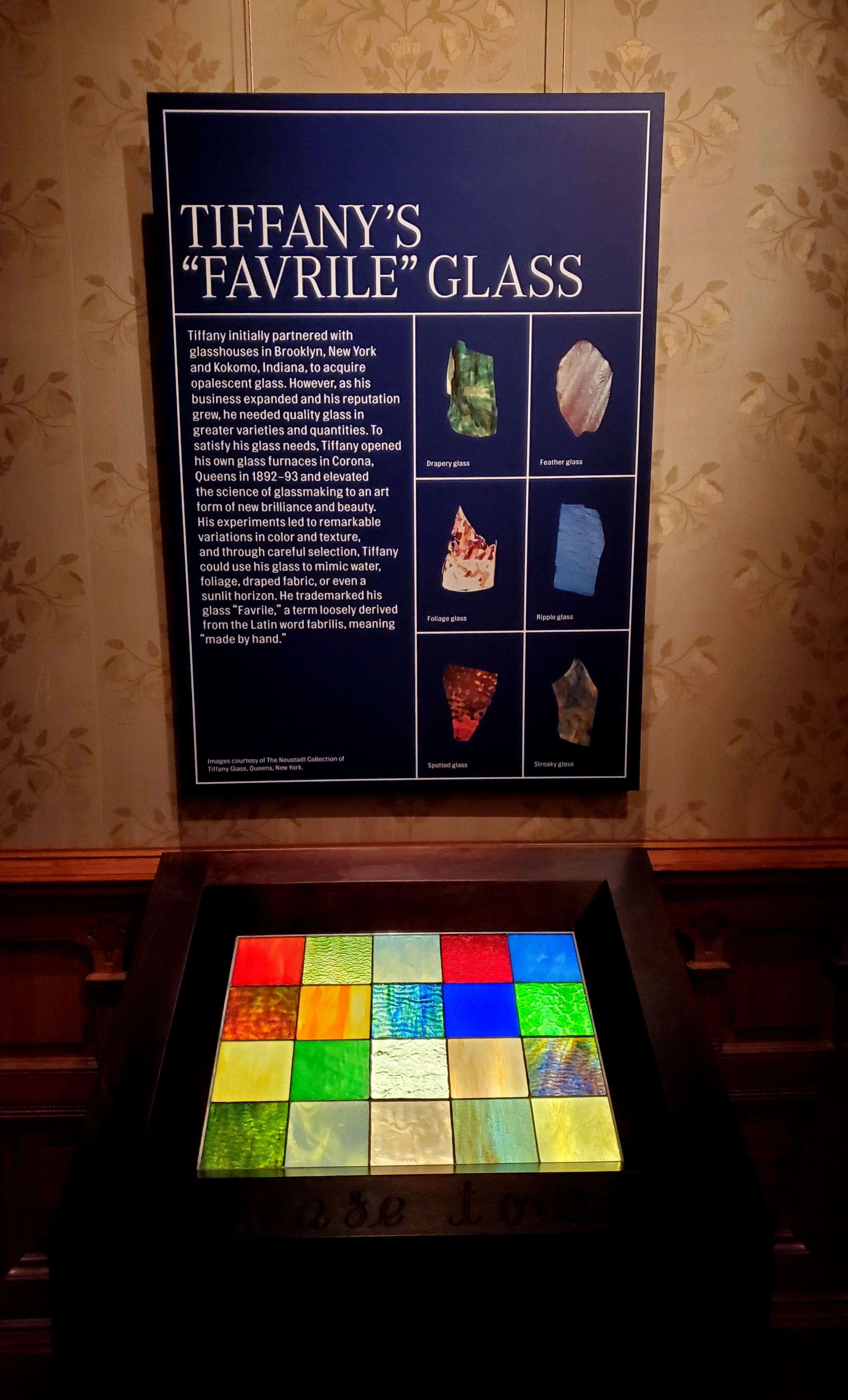 This display offers visitors to touch the different types of glass used by Tiffany