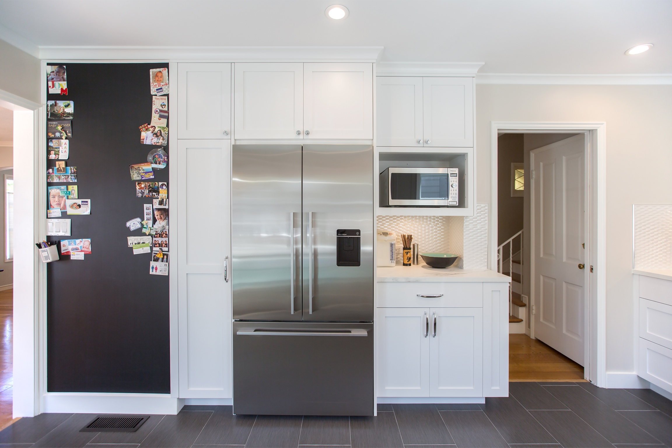 william-adams-design-clement-kitchen-white-cabinets-grey-tile-floors-stainless-steel-refrigerator.jpg