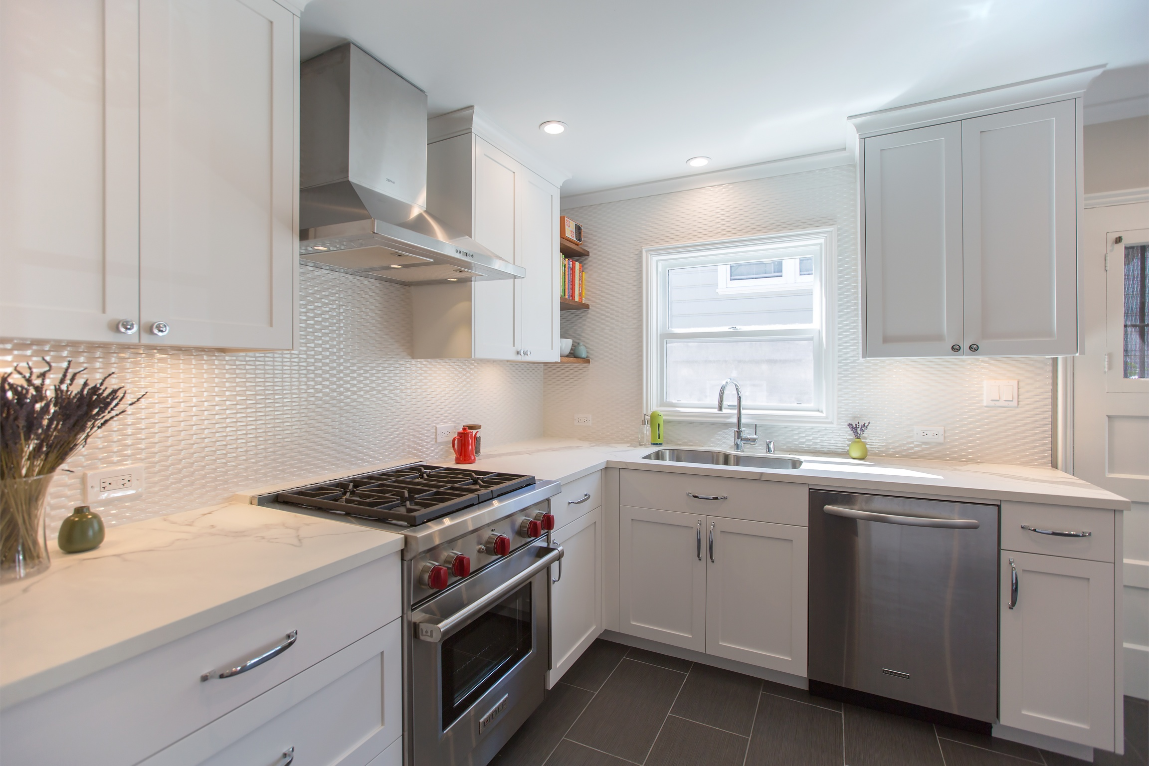 william-adams-design-clement-kitchen-white-cabinets-grey-tile-floors-white-backsplash-range-sink-dishwasher.jpg