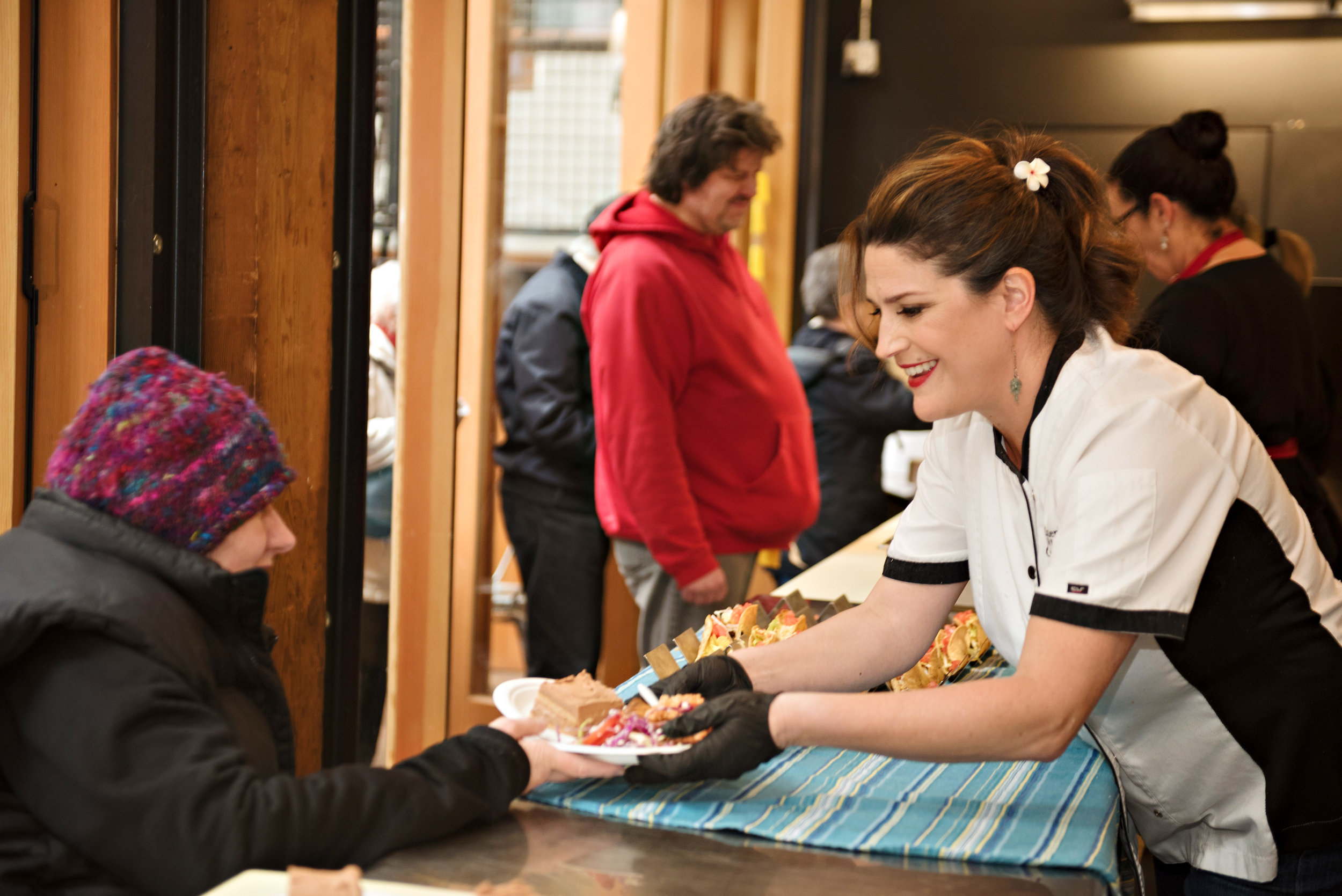 Chef Traci Calderon feeding our community at Atrium Kitchen at Pike Place Market