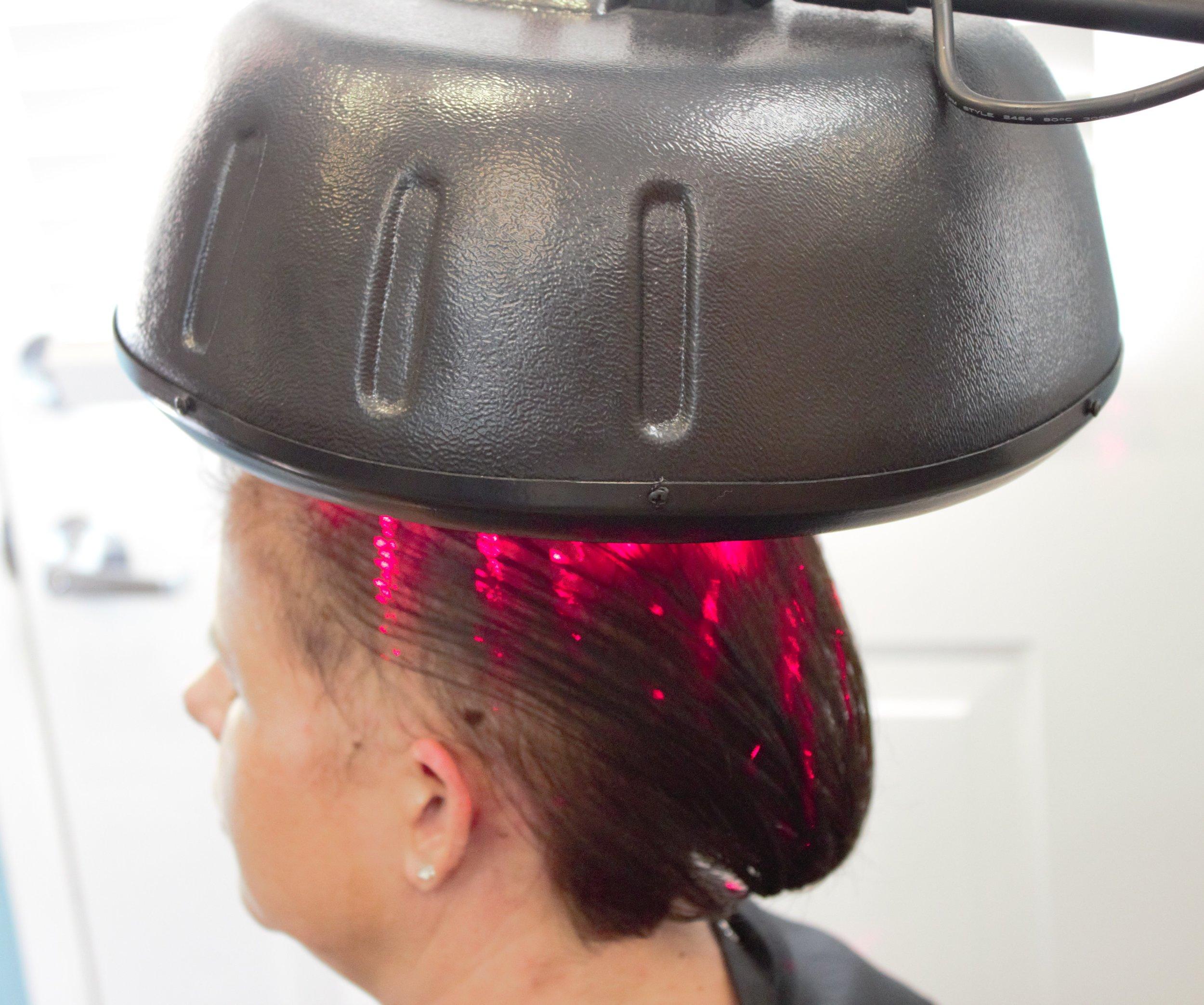 Woman receiving Low Level Light Hair Treatment