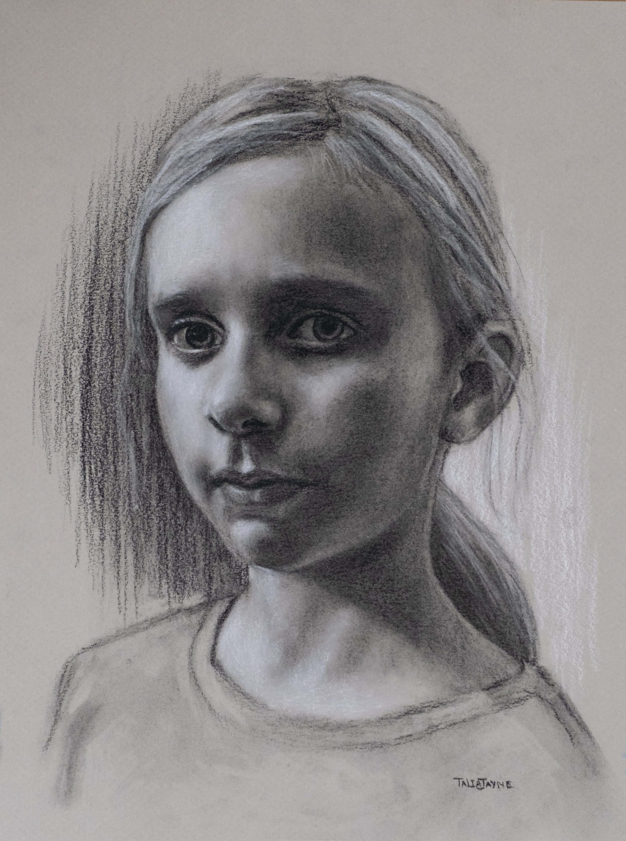 Charcoal and White chalk portrait drawing on toned paper.