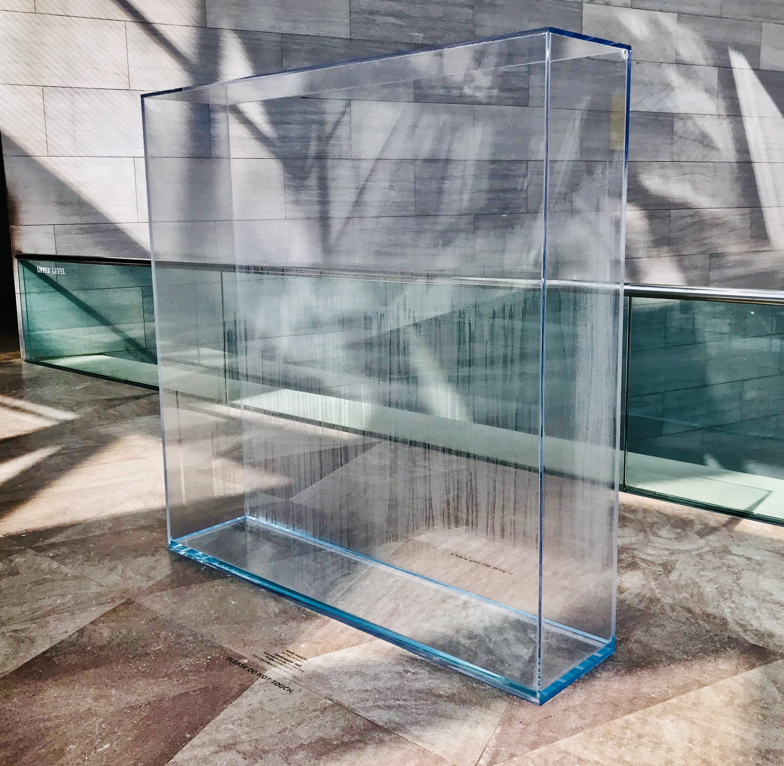 Hans Haacke,  Condensation Wall,  conceived 1963/1966, fabricated 2016, Plexiglas and distilled water, overall: 177.8 × 177.8 × 40.6 cm (70 × 70 × 16 in.)National Gallery of Art, Gift of the Collectors Committee, 2013.44.1. Photograph by Emily Lanza.