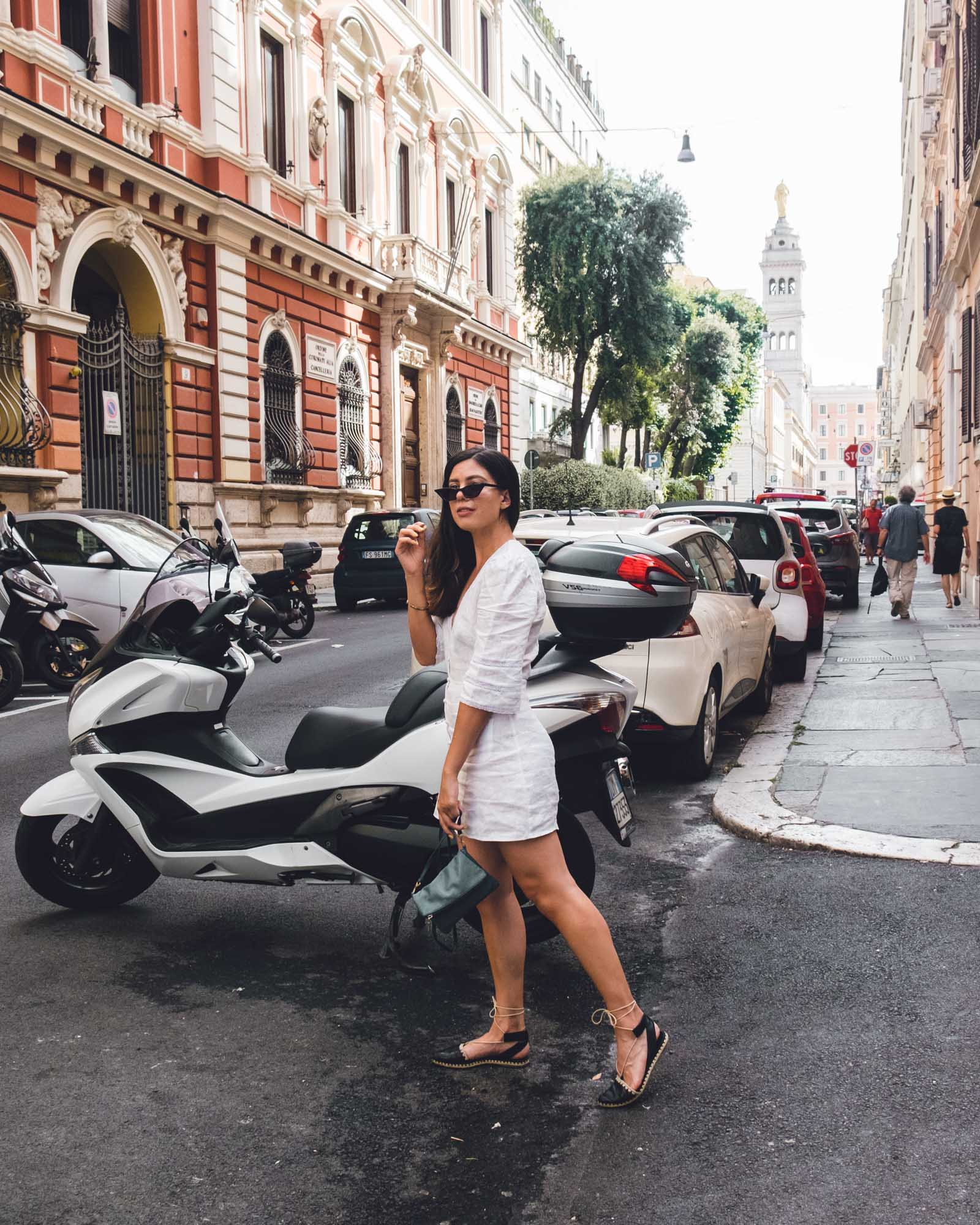 Rachel Off Duty: Woman in Front of a Vespa