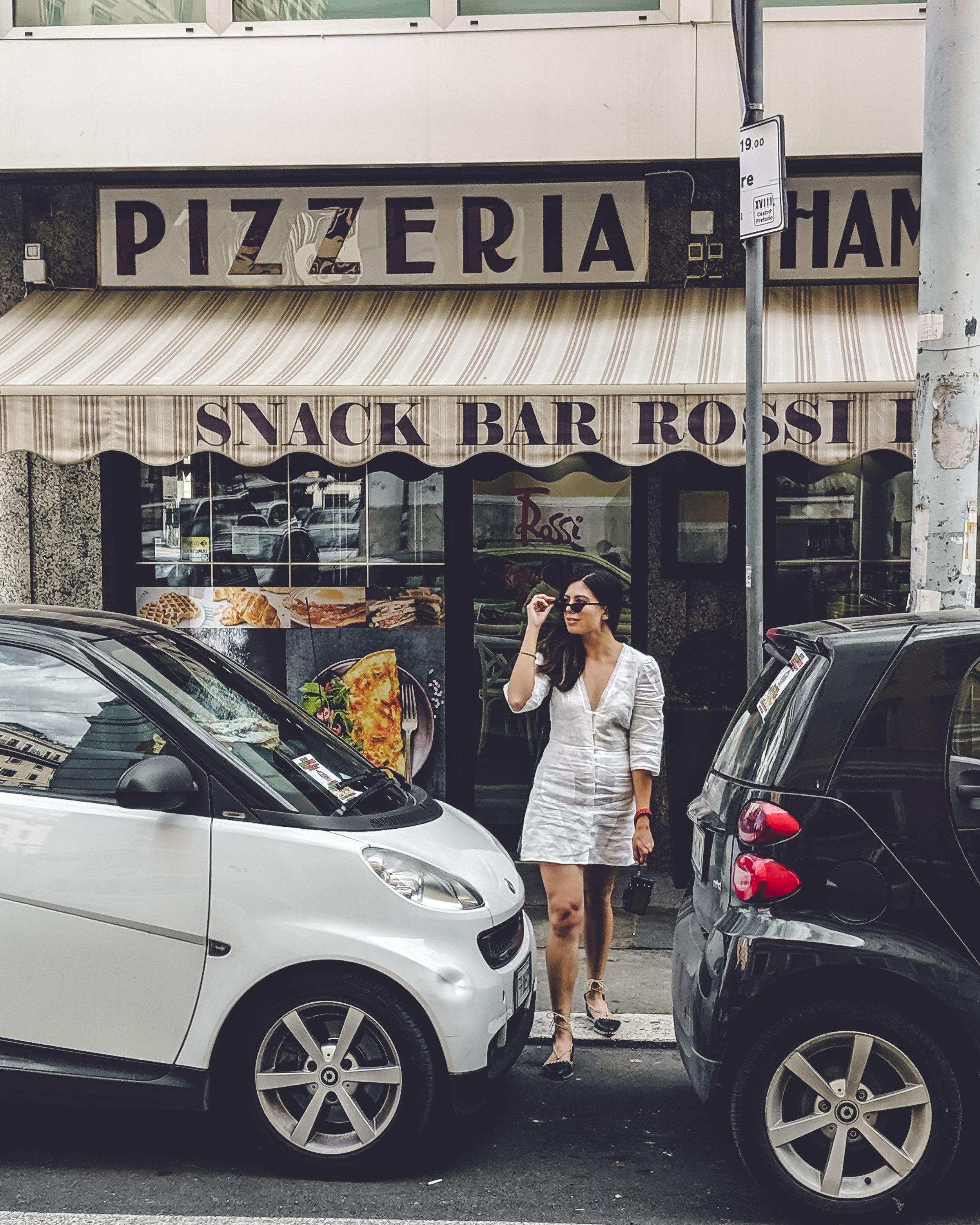 Rachel Off Duty: Woman Outside a Pizzeria