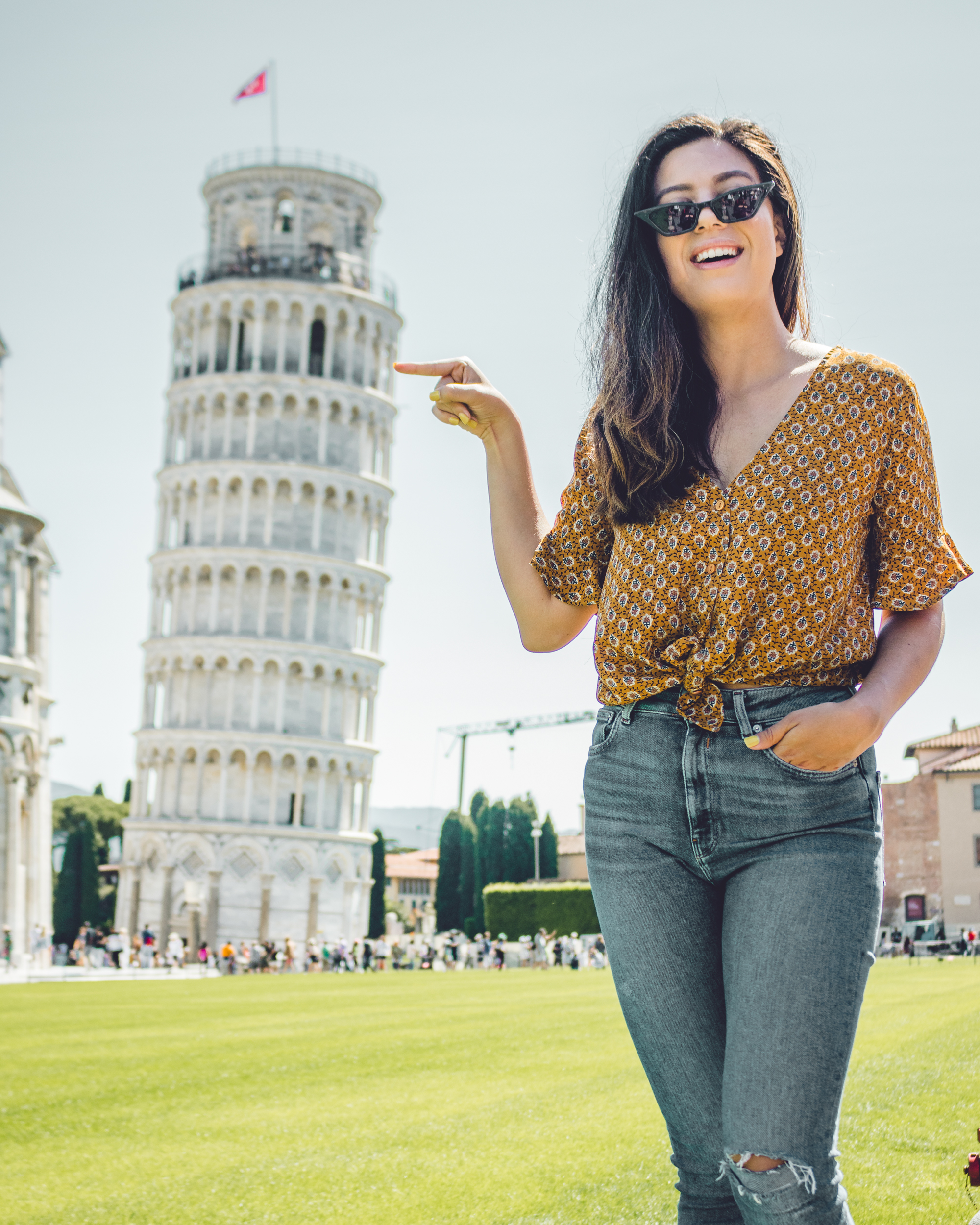 Rachel Off Duty: Woman in Front of the Leaning Tower of Pisa