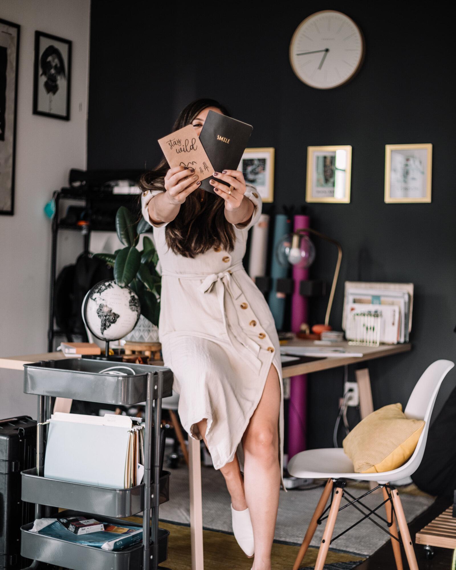 Rachel Off Duty: Rachel Holding 2 Notebooks in An Office