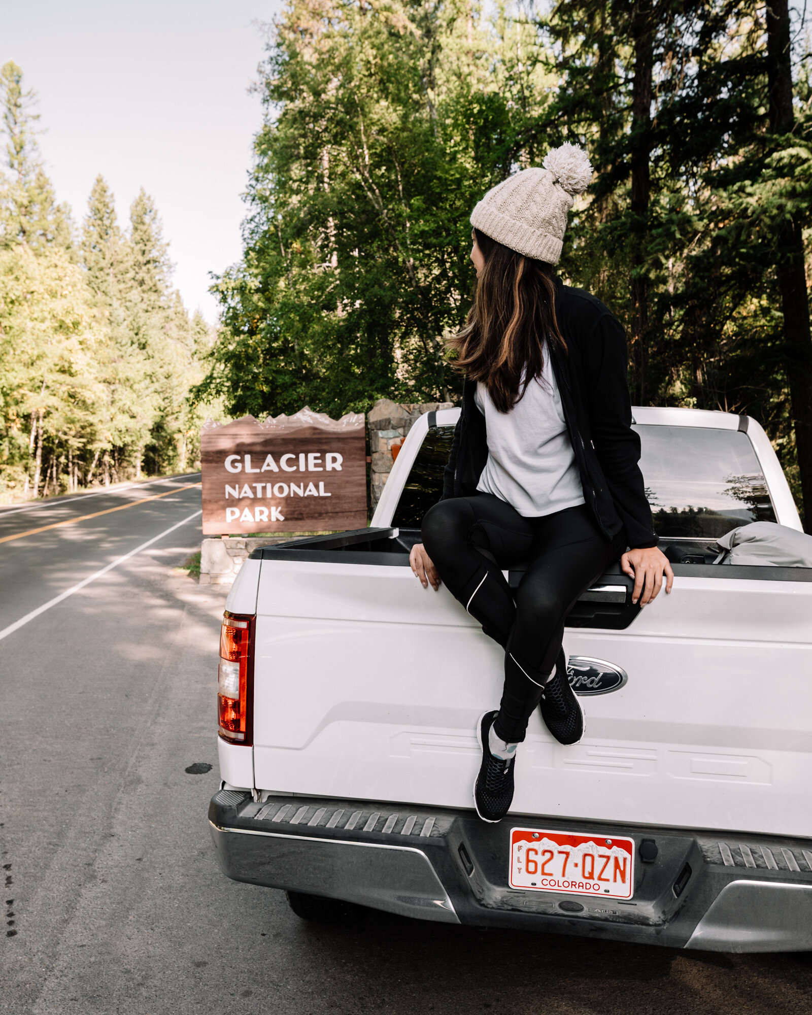 Rachel Off Duty: Woman Sitting on a Truck in Glacier National Park