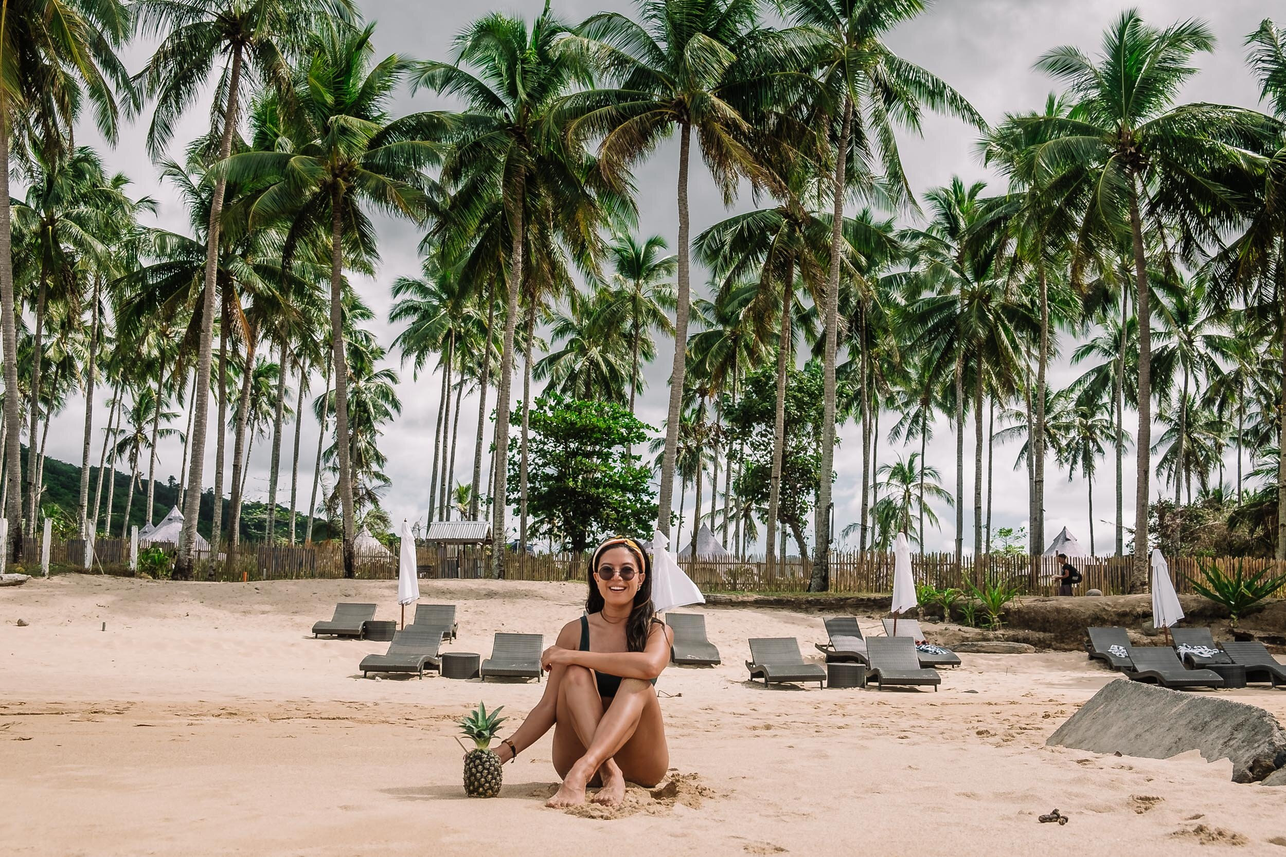 Rachel Off Duty: Woman on the Beach with a Pineapple, Philippines