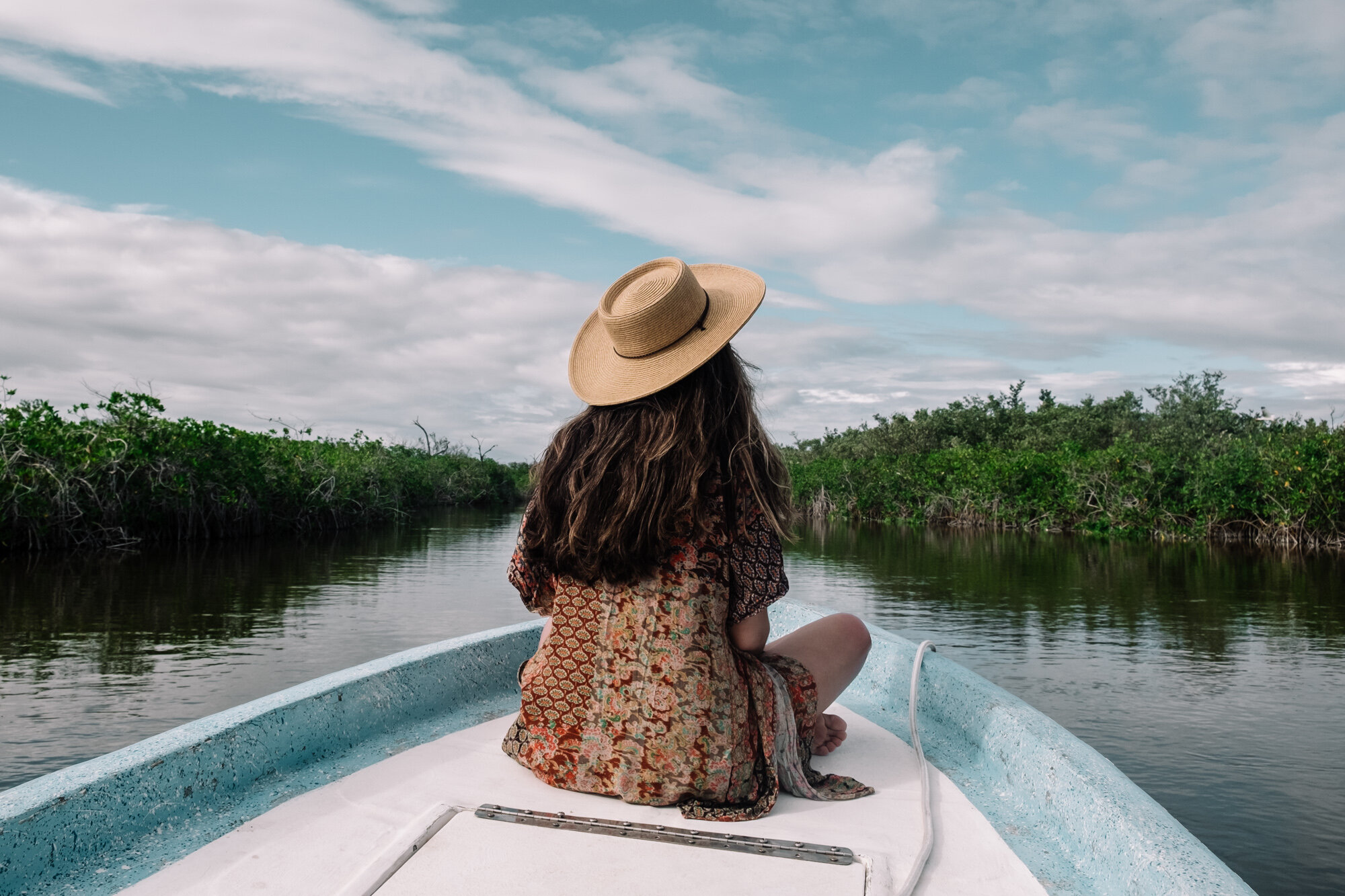 Rachel Off Duty: Woman On a Boat Visiting the Mangroves in Sian Kaan, Tulum, Mexico