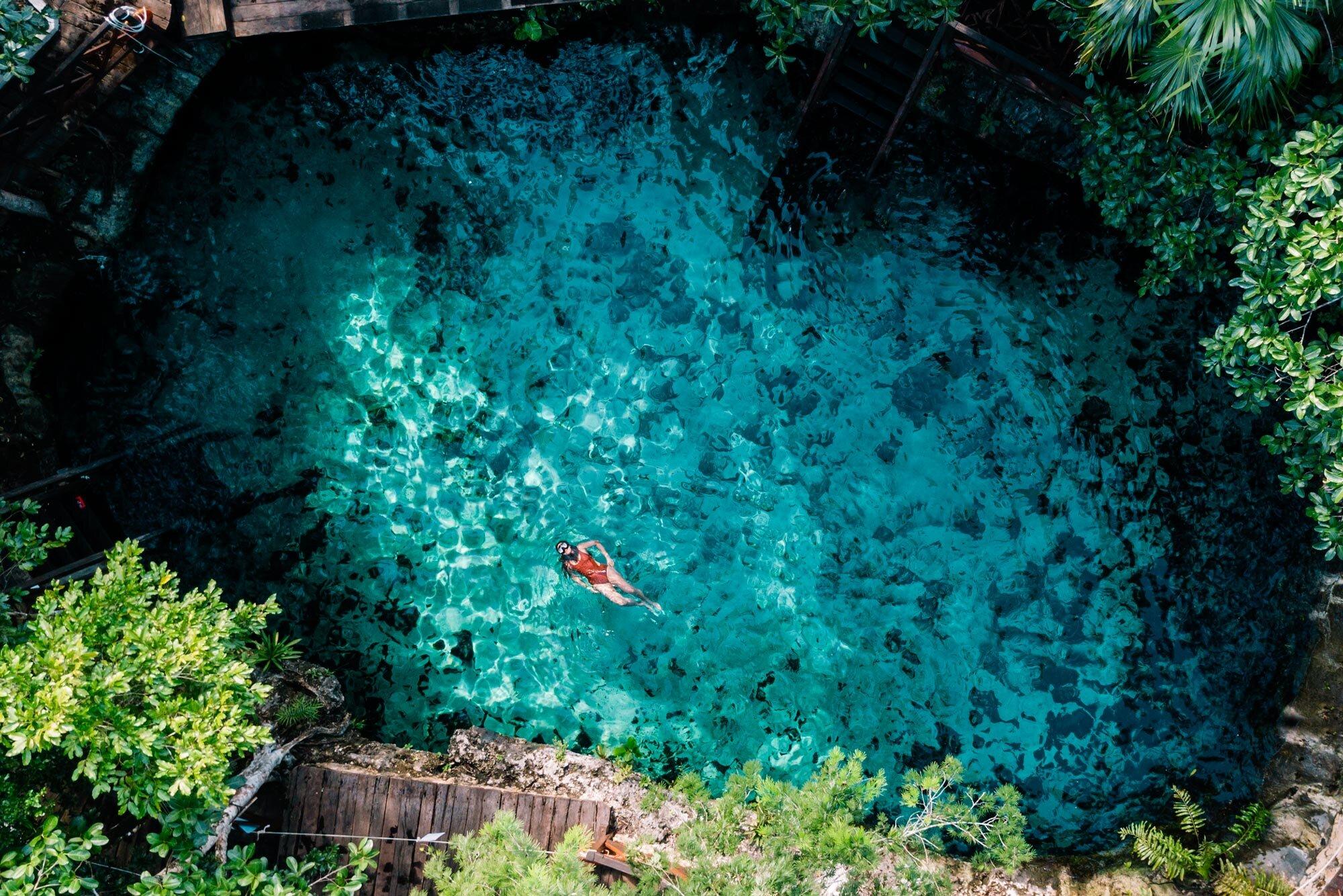 Rachel Off Duty: A Woman Floating in Cenote Zacil-Ha, Tulum, Mexico