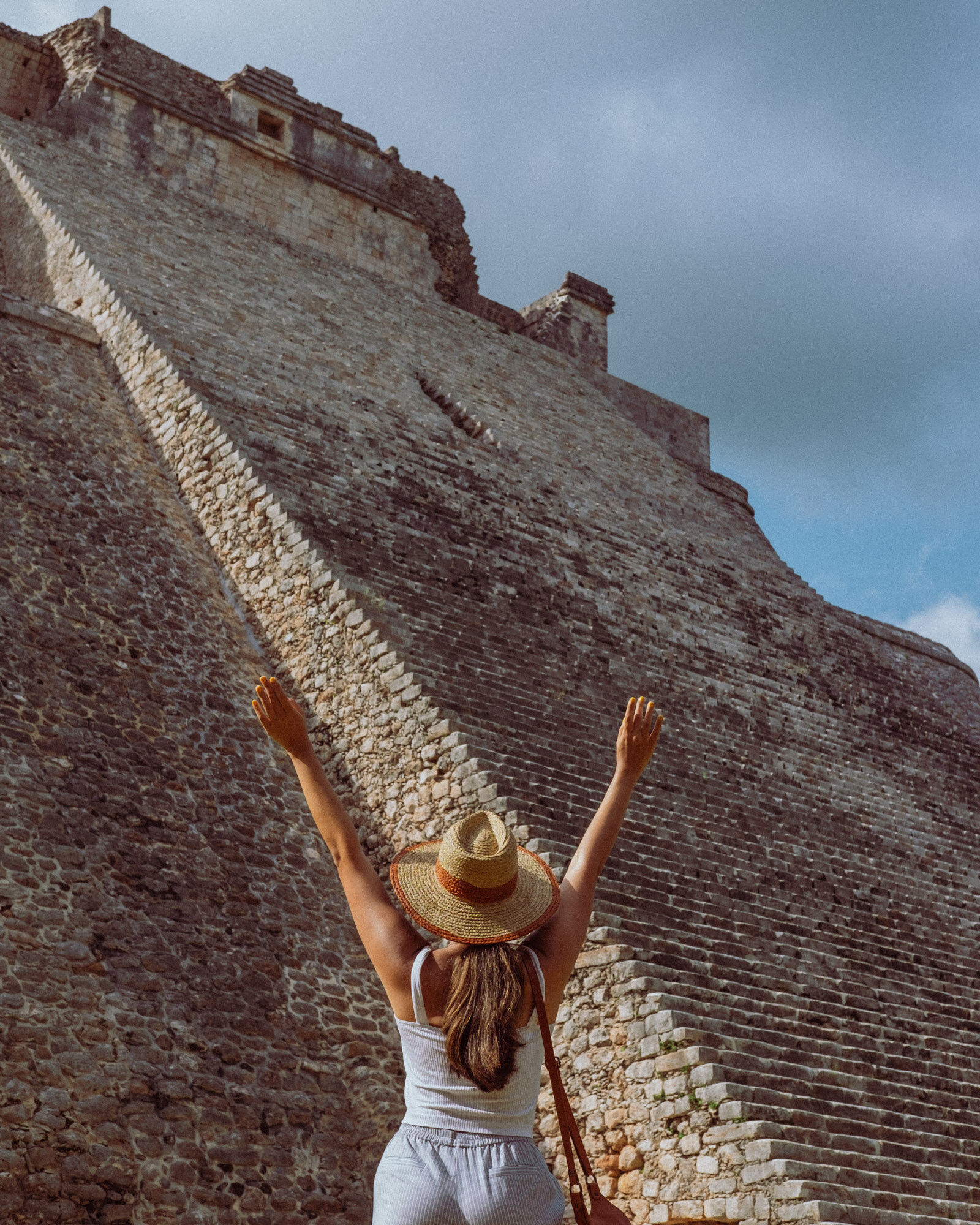Rachel Off Duty: A Woman Stands in Front of the Pyramid of the Magician at Uxmal, Mexico