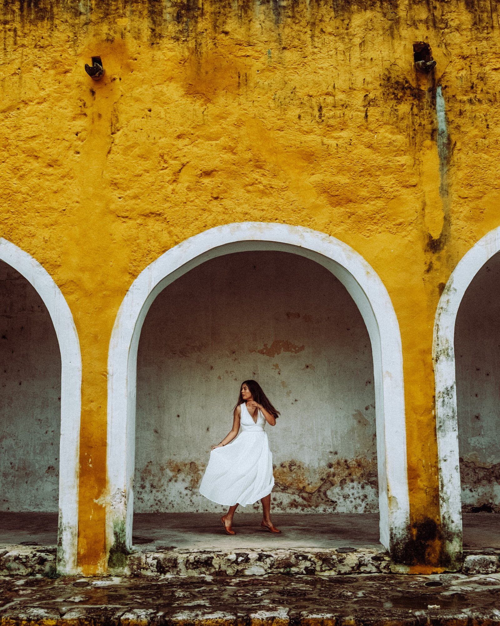 Rachel Off Duty: A Woman Framed in an Archway in Izamal, Mexico