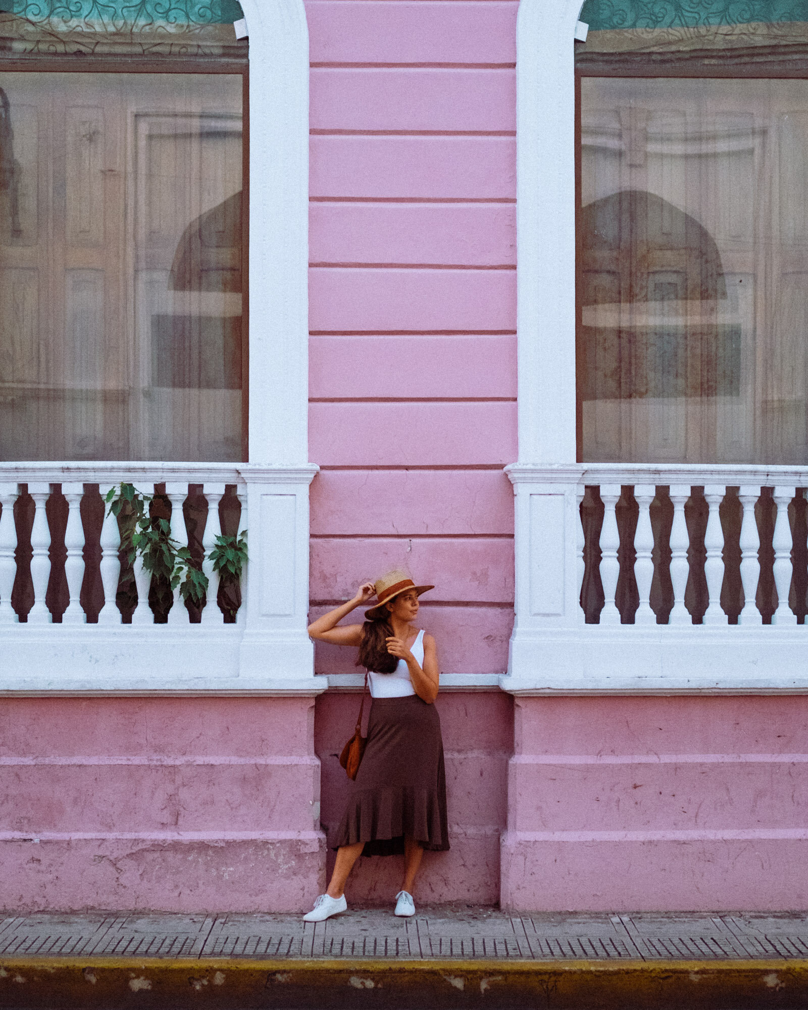 Rachel Off Duty: A Woman Stands in Front of a Pink Building in Merida, Mexico