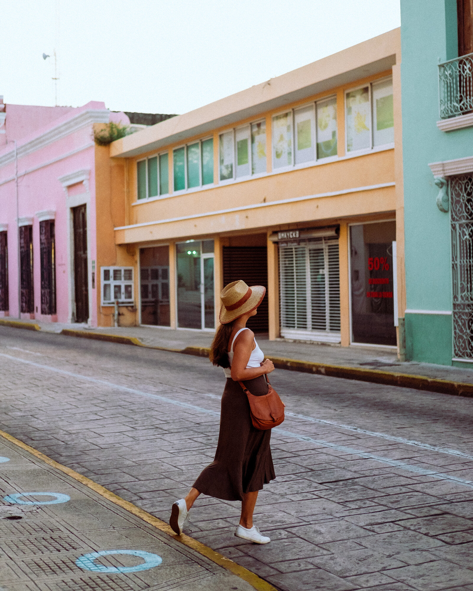 Rachel Off Duty: A Woman Walking Through the Colorful Streets of Merida