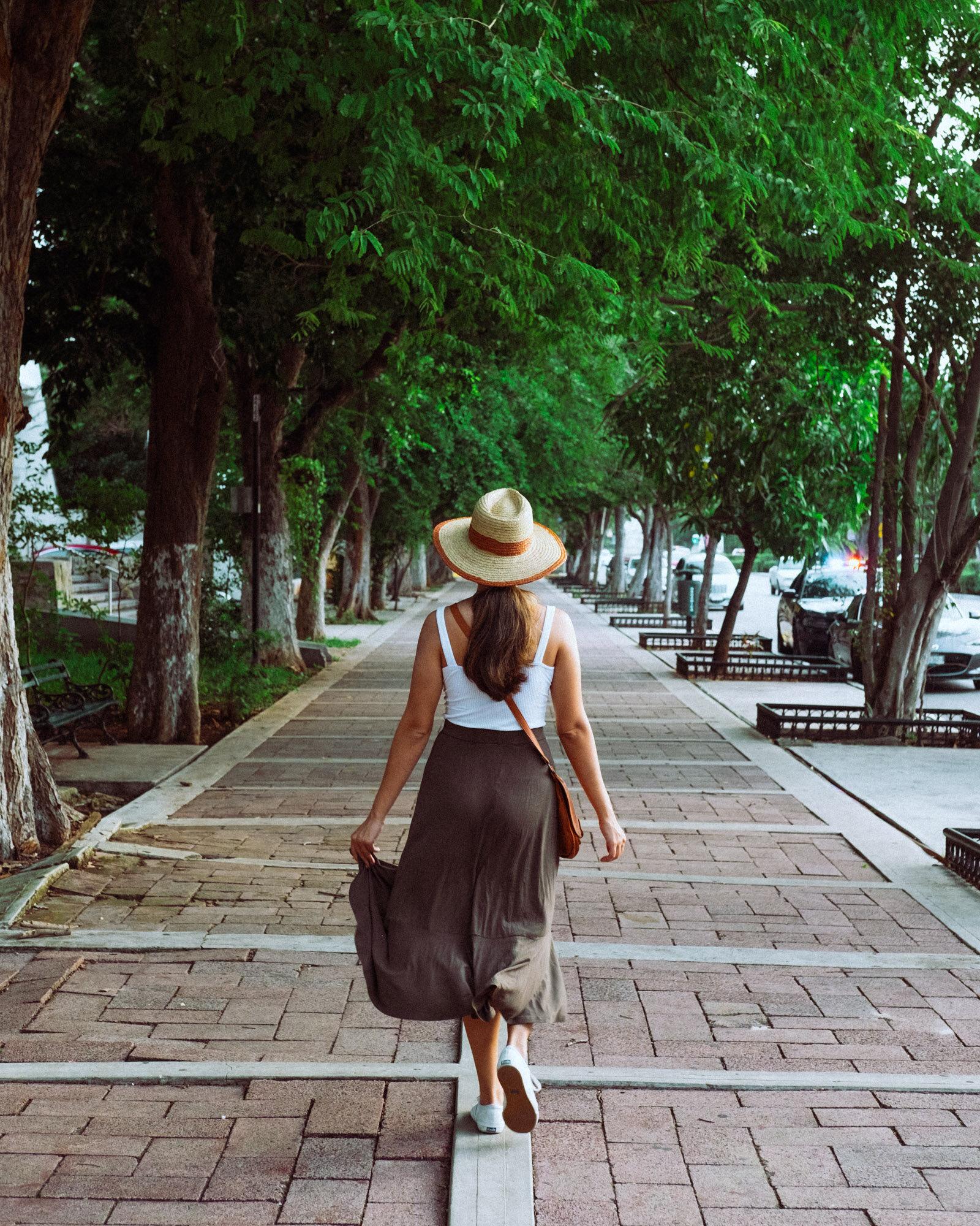 Rachel Off Duty: Woman Walking down a Sidewalk in Merida, Mexico