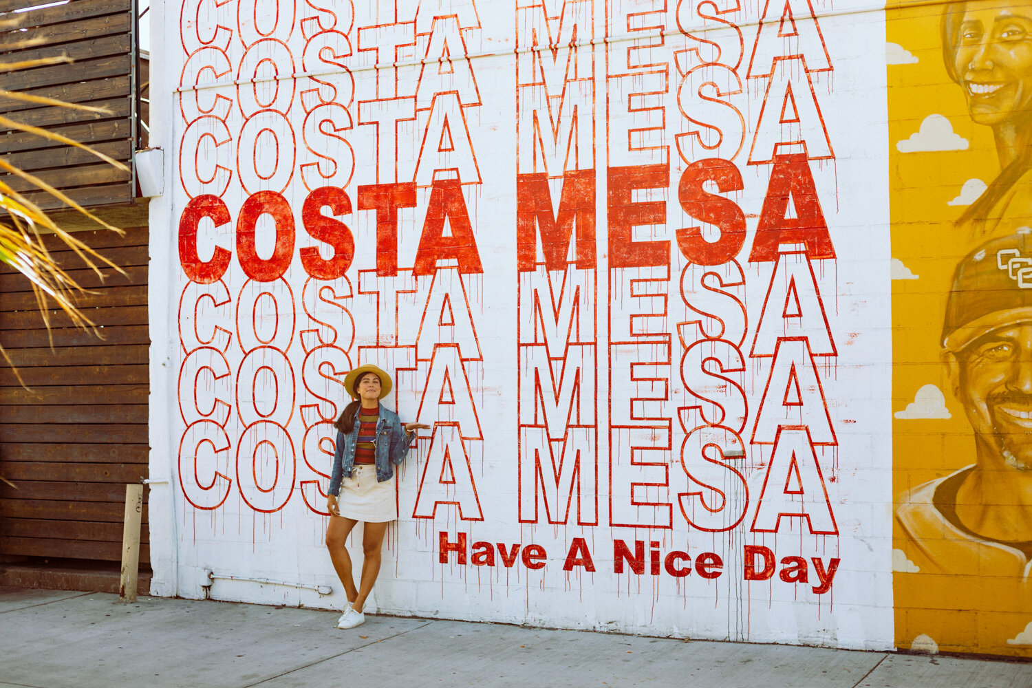 Rachel Off Duty: A Woman Standing in Front of a Red and White Costa Mesa Mural