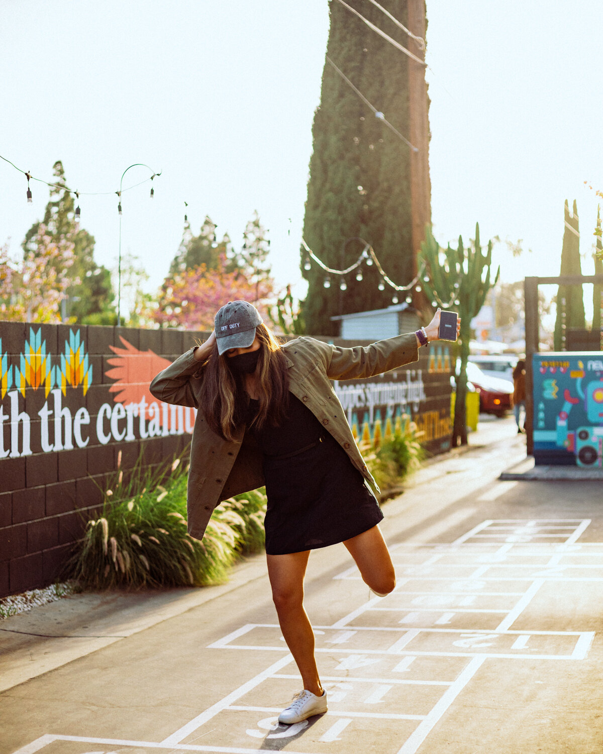 Rachel Off Duty: A Woman in a Dress Playing Hopscotch at The LAB in Costa Mesa
