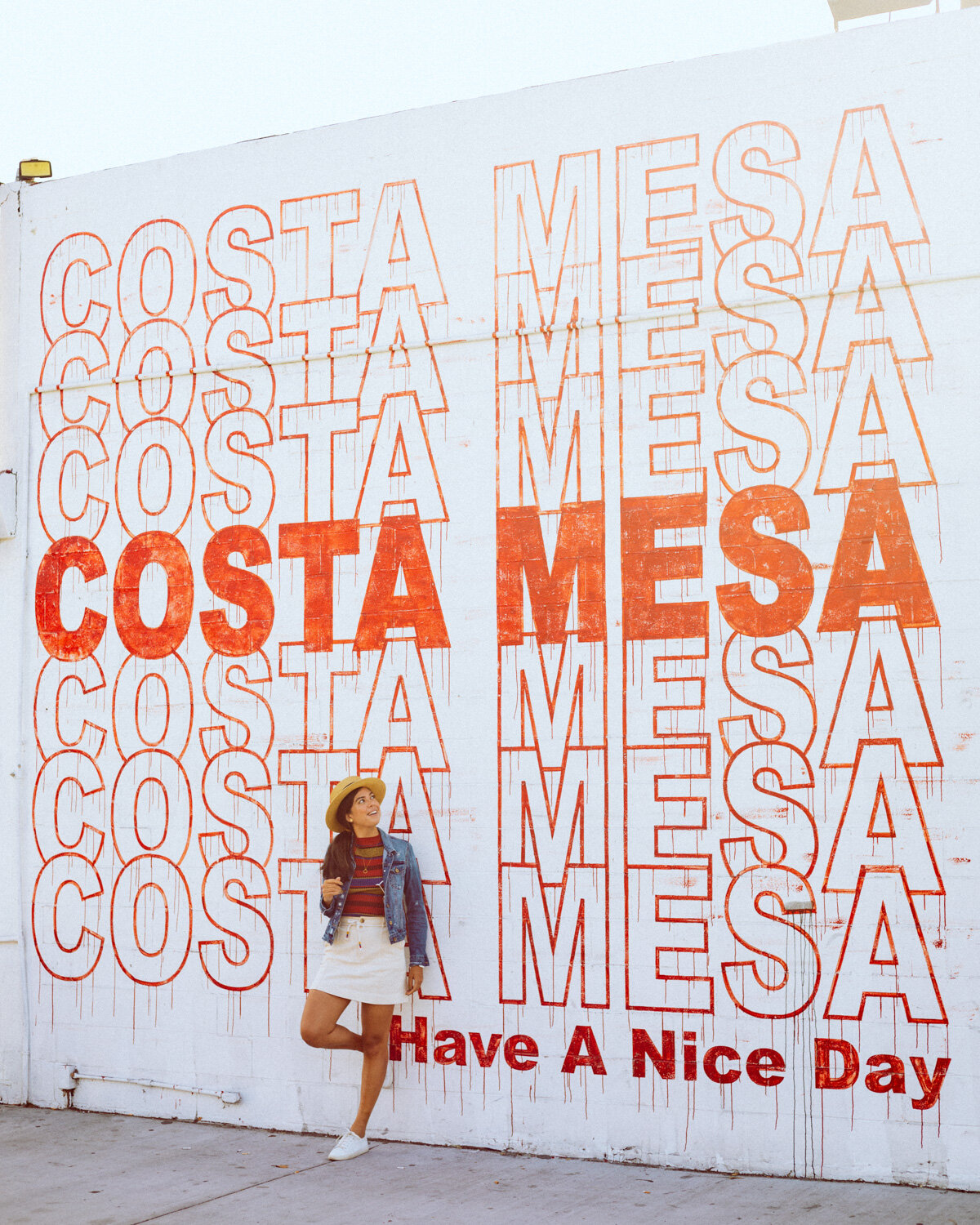 Rachel Off Duty: A Woman Standing and Leaning against the Costa Mesa Have a Nice Day Mural
