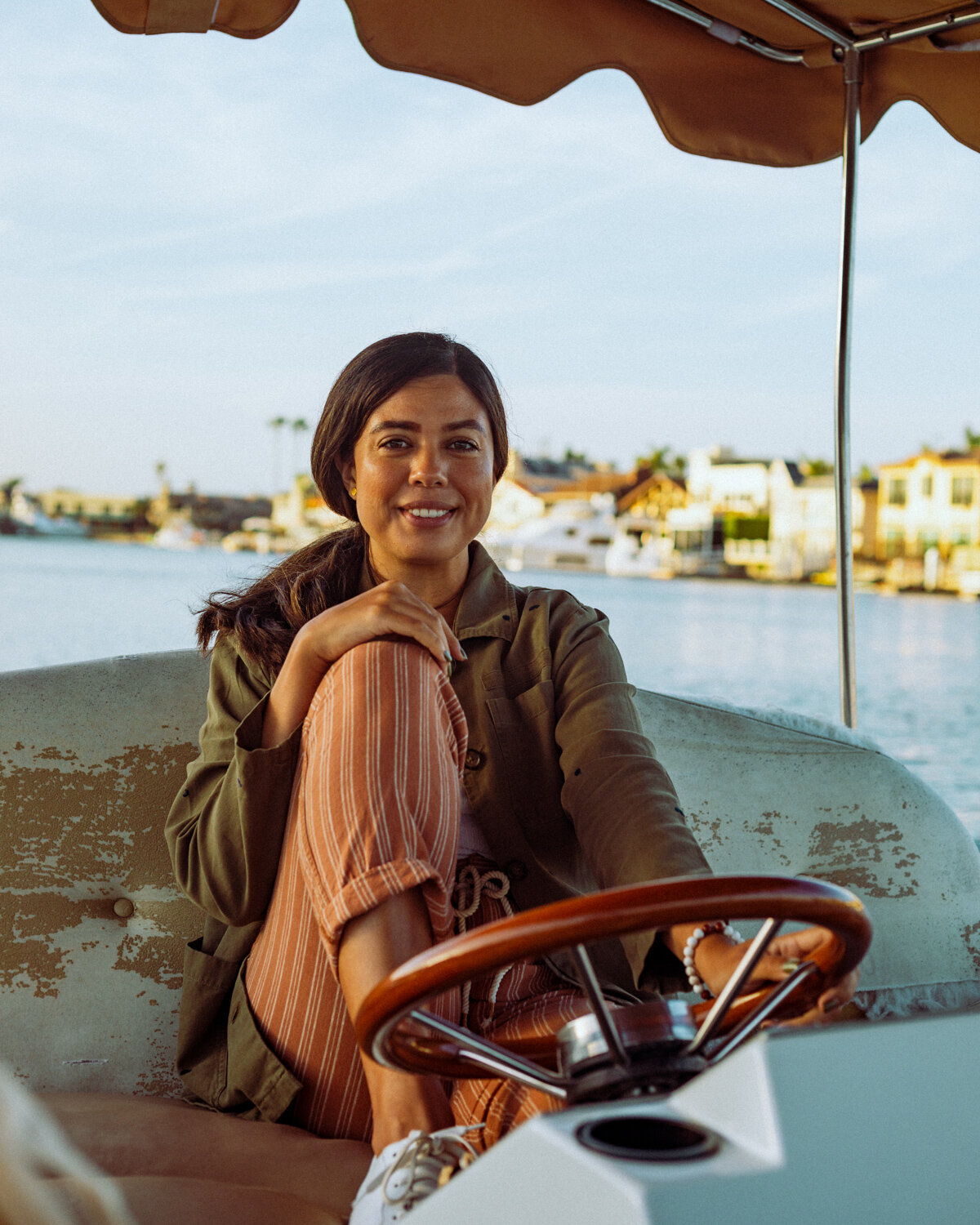 Rachel Off Duty: A Woman in Pink Striped Pants Driving a Duffy Boat in Huntington Harbour