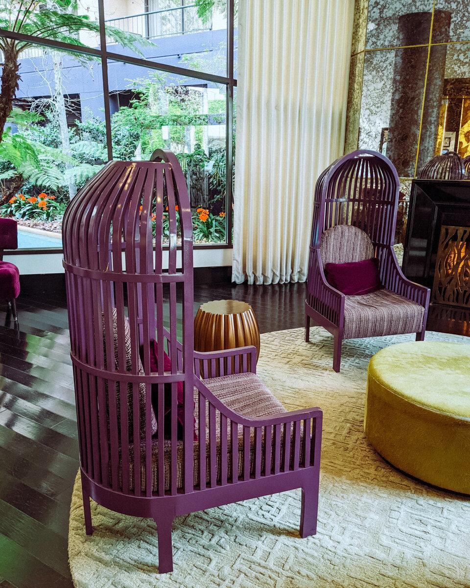 Rachel Off Duty: Large Purple Birdcage Chairs in a Hotel Lobby