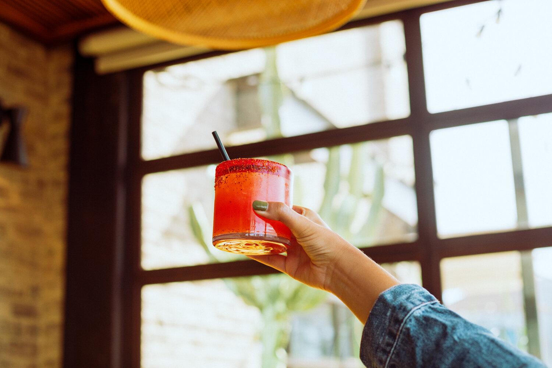 Rachel Off Duty: A Hand Holding a Watermelon Margarita from Playa Mesa