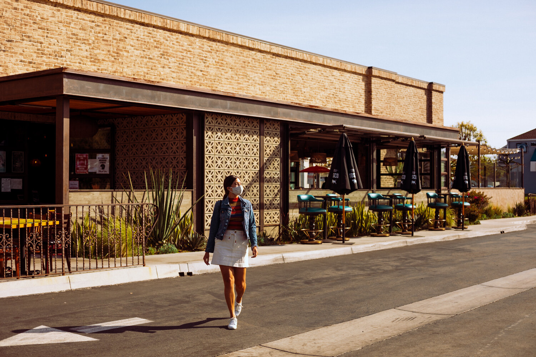 Rachel Off Duty: A Woman Walking Out of a Restaurant in Costa Mesa