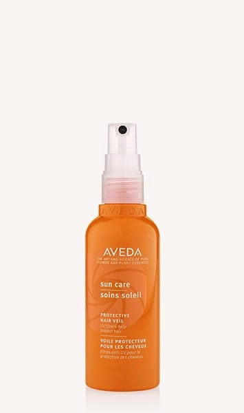 SUN CARE | PROTECTIVE HAIR VEIL  AKA hair sunscreen, if you will. This must have is a lightweight, water-resistant UV defense mist that forms an invisible screen (wow) to help protect hair your from sun exposure while minimizing damage and dryness. Bonus: it can be used on all hair types.