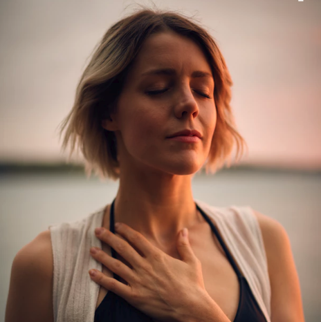 meditation lady hand on chest.png
