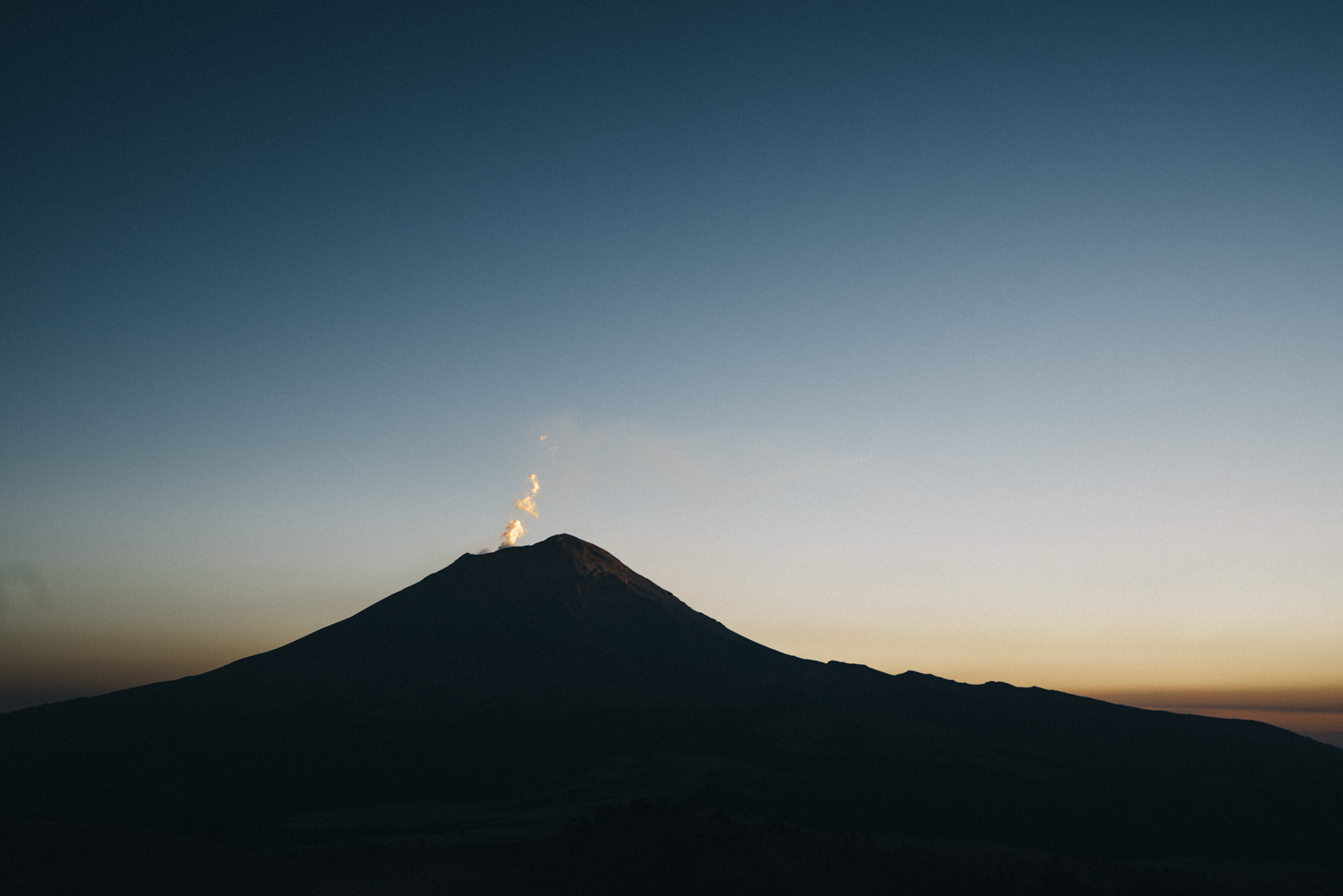 Volcanic gas rises from Mt. Popocatepetl, The Warrior, at sunset.