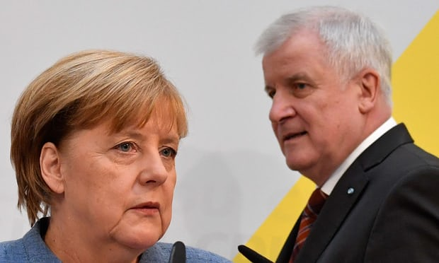 Photo: Angela Merkel and Horst Seehofer, leader of the CDU's Bavarian sister party CSU.   Photo Courtesy: John Macdougall/AFP/Getty Images