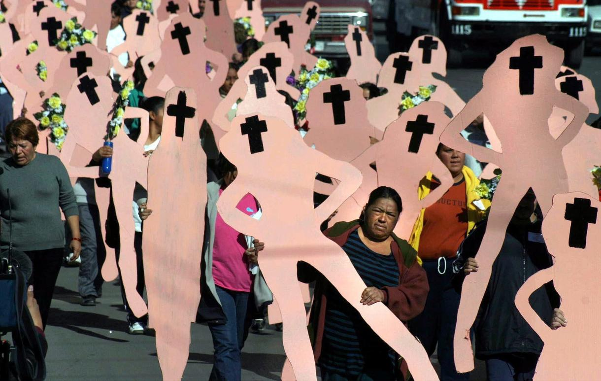 Photo: Relatives of women murdered in Ciudad Juárez march for justice.  Photo Courtesy: Guadalupe Perez/EPA