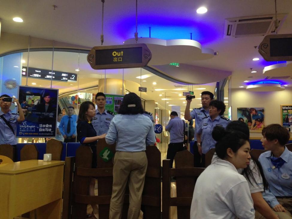 An immigration raid on the Chengdu Disney English office.    Credit: Vice