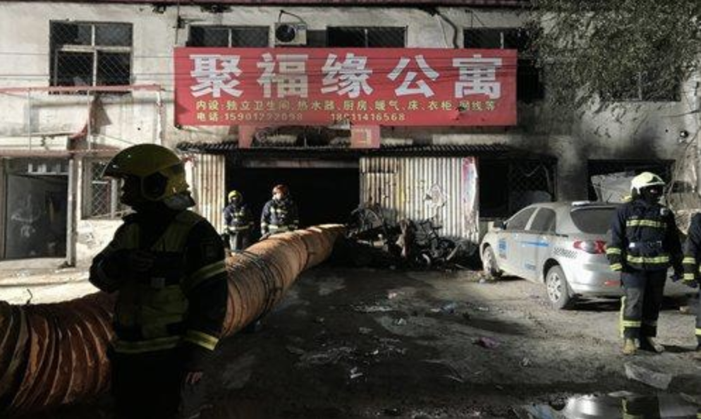 Firefighters walked the site of a fire that killed 19 people in the Daxing district.  Source: Visual China Group