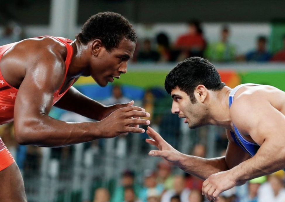 Alireza Karimi, right, loses to American J'Den Cox at the 2016 Olympics in Rio de Janeiro, to avoid wrestling an Israeli in the following round. (Photo: CreditJack Guez/Agence France-Presse — Getty Images)