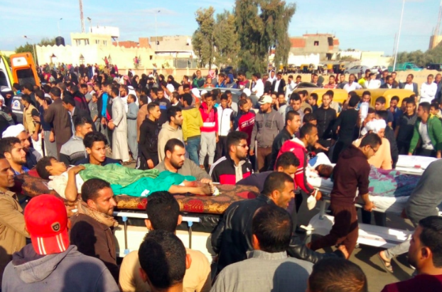Citizens of the Egyptian Sinai carry a wounded victim of the al-Rawda massacre. (AFP/Getty Images)