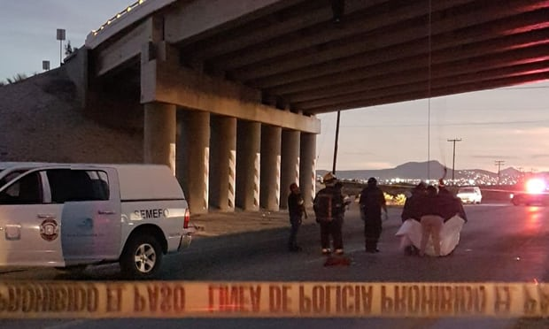 Rescuers attend to bodies that were left hanging on the freeway to La Paz, Baja California Sur, Mexico (Reuters)