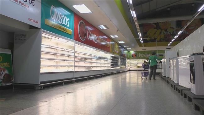 An empty store in Caracas, Venezuela (PressTV)