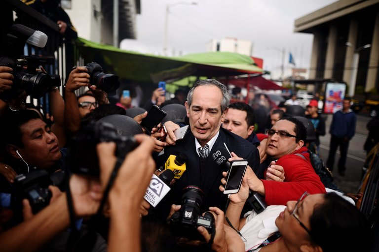 Former President Álvaro Colom of Guatemala, center, was arrested Tuesday in Guatemala City in connection with a corruption investigation (New York Times)