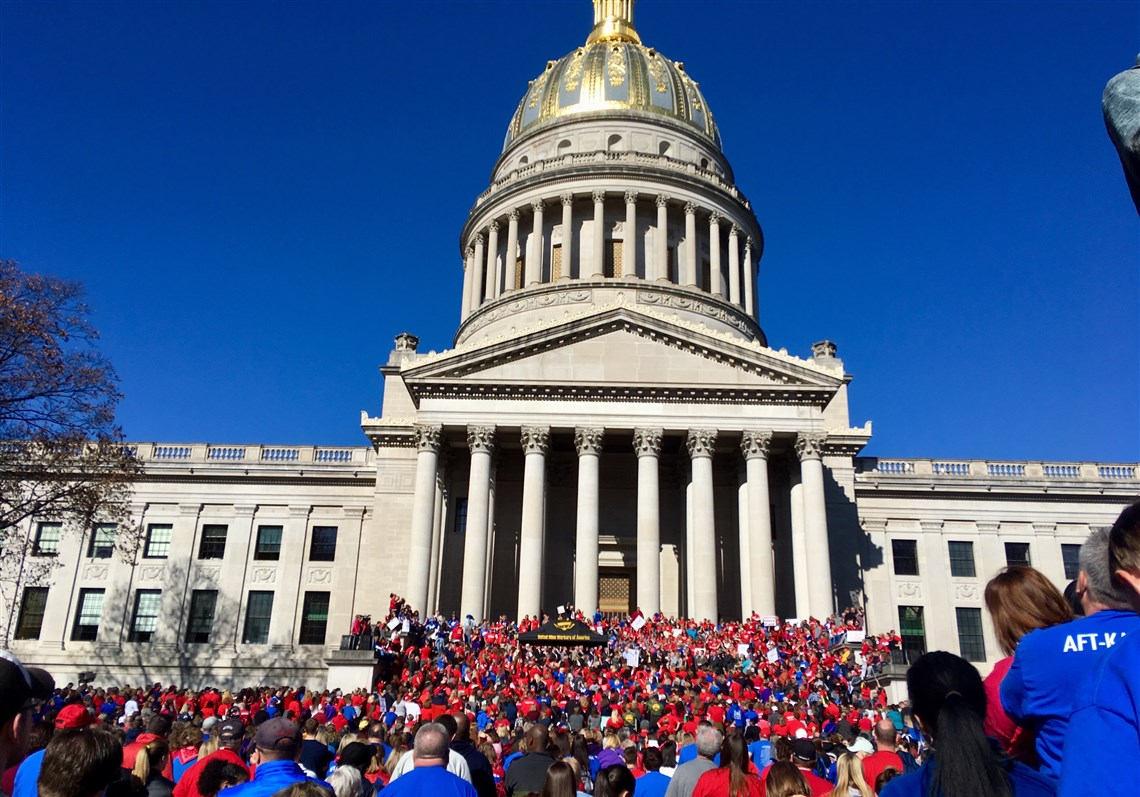 Protesters Rally at the Steps of the Virginia State Capitol  (Source: John Raby/AP Photo)