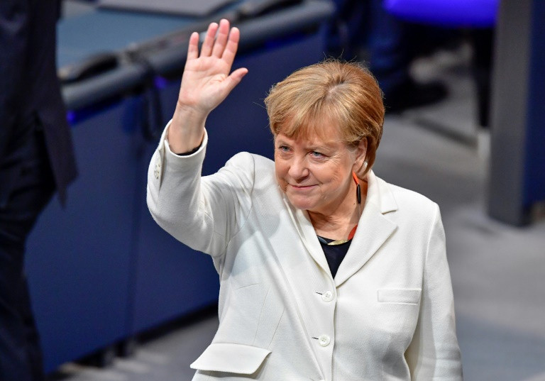 Angela Merkel greets the Bundestag after being re-elected Chancellor of Germany on Mar. 14, 2018. Photo: AFP / Tobias Schwarz