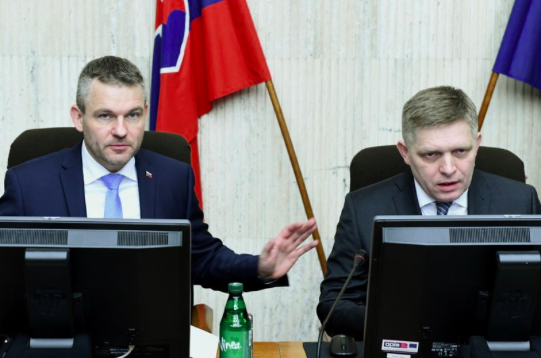 Slovak Prime Minister Robert Fico (right) chairs his last Cabinet meeting on Mar. 15, 2018, prior to his resignation later that same day. Slovak President Kiska appointed Fico's deputy Peter Pellegrini (left) as Fico's successor.  (Photo: Pavel Neubauer/TASR via AP)