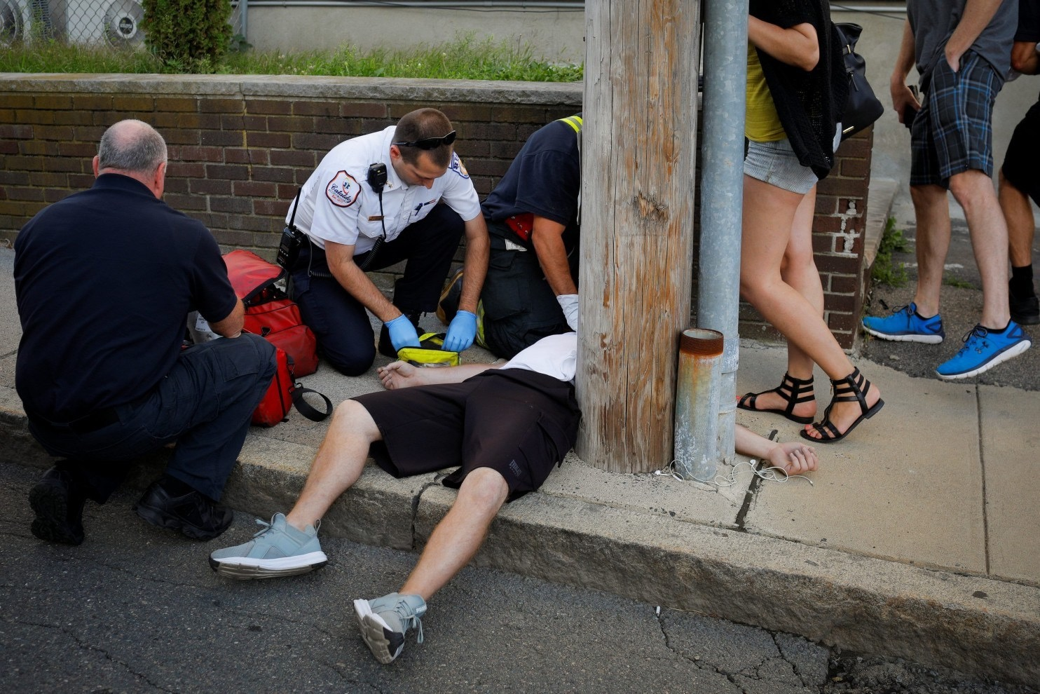 First Responders Revive a Man after an Opioid Overdose. (Source: Brian Snyder/Reuters)