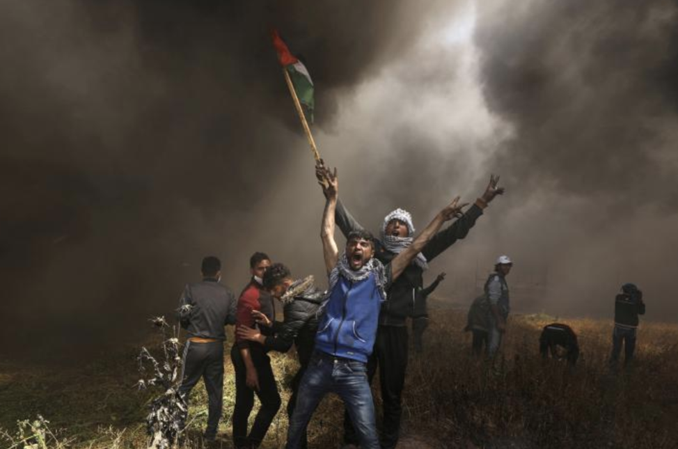 Palestinians shouting during the protests on the Gaza-Israel border on Friday. From: https://www.reuters.com/news/picture/deadly-protests-on-gaza-israel-border-idUSRTX5LMUG