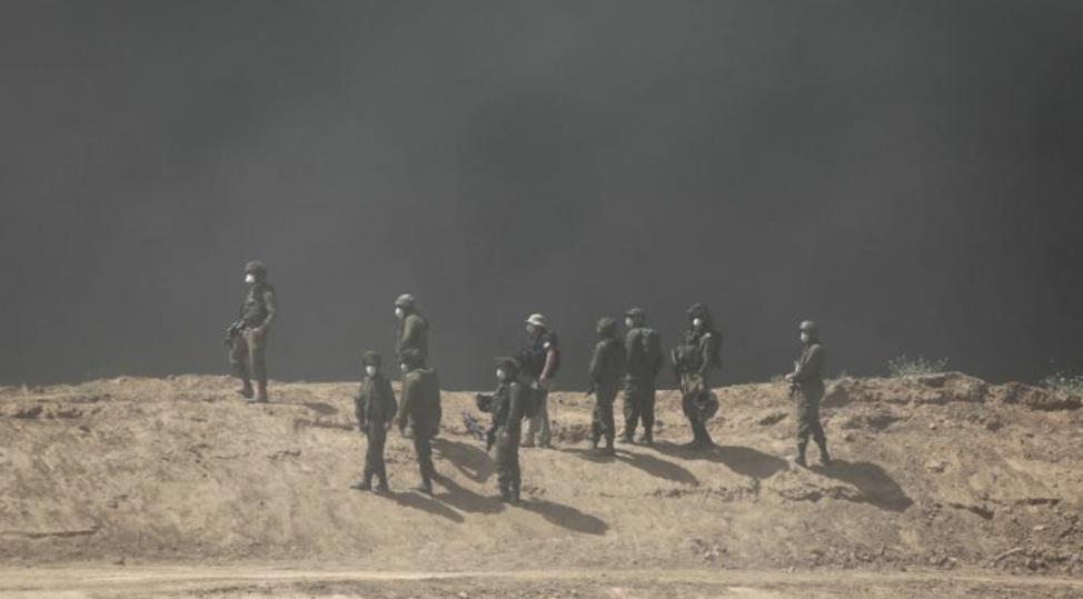Israeli soldiers standing in smoke during protests at the Gaza-Israel border on Friday. From: https://www.cnn.com/2018/04/07/middleeast/gaza-israel-border-protest-deaths-intl/index.html