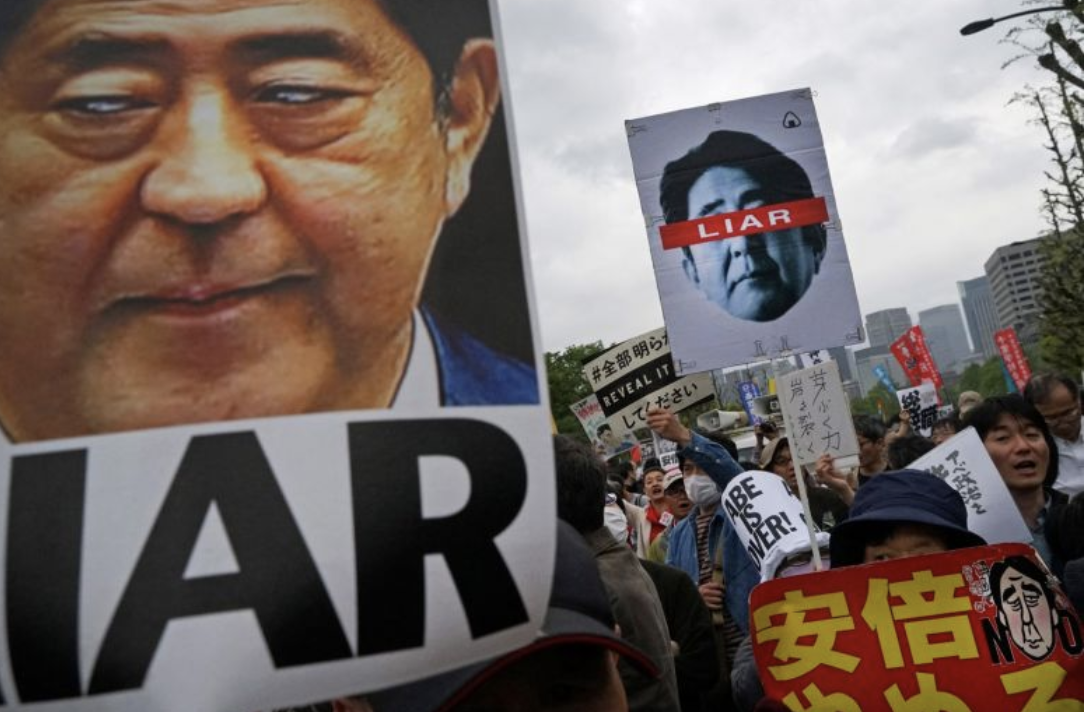 [Demonstrators carrying signs and posters protest against Prime Minister of Japan Shinzo Abe outside of the National Diet Building in Tokyo, Japan, on Apr. 14, 2018. Photo: Bloomberg]