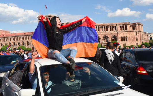 Armenians celebrate the resignation of Prime Minister Serzh Sarksyan in downtown Yerevan on Apr. 23, 2018. Photo: Hayk Baghdasaryan (EPA-EFE)