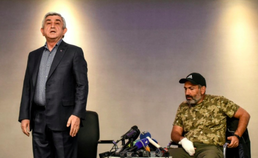 Embattled then-Prime Minister of Armenia Serzh Sarkysan (left) storms out of tense televised talks with opposition leader Nikol Pashinyan on Sunday, Apr. 22, 2018. Photo: AFP/File/Vano Shlamov