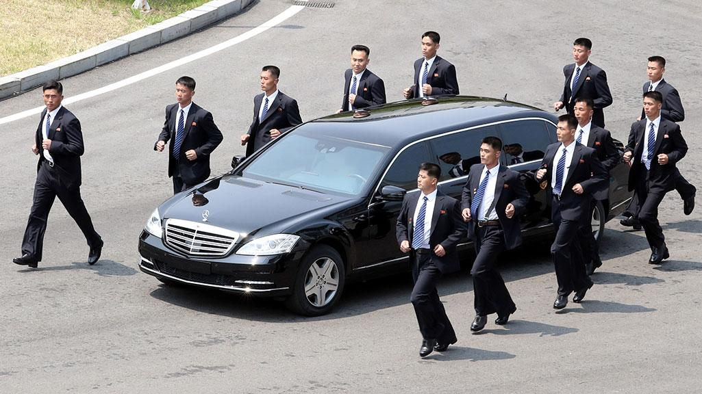 (Bodyguards run next to Kim Jong-un's Mercedes. Source:  The Independent )