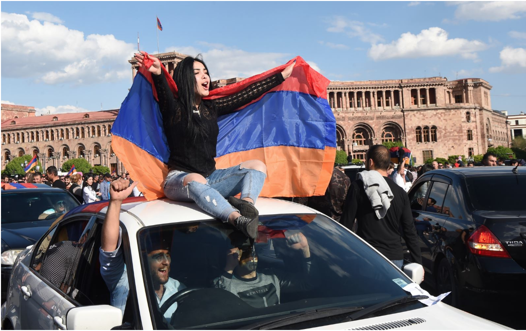 [Armenians celebrate the resignation of Prime Minister Serzh Sarksyan in downtown Yerevan on Apr. 23, 2018. Photo: Hayk Baghdasaryan (EPA-EFE)]